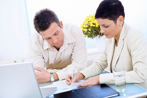 Couple listing their creditors for their bankruptcy filing